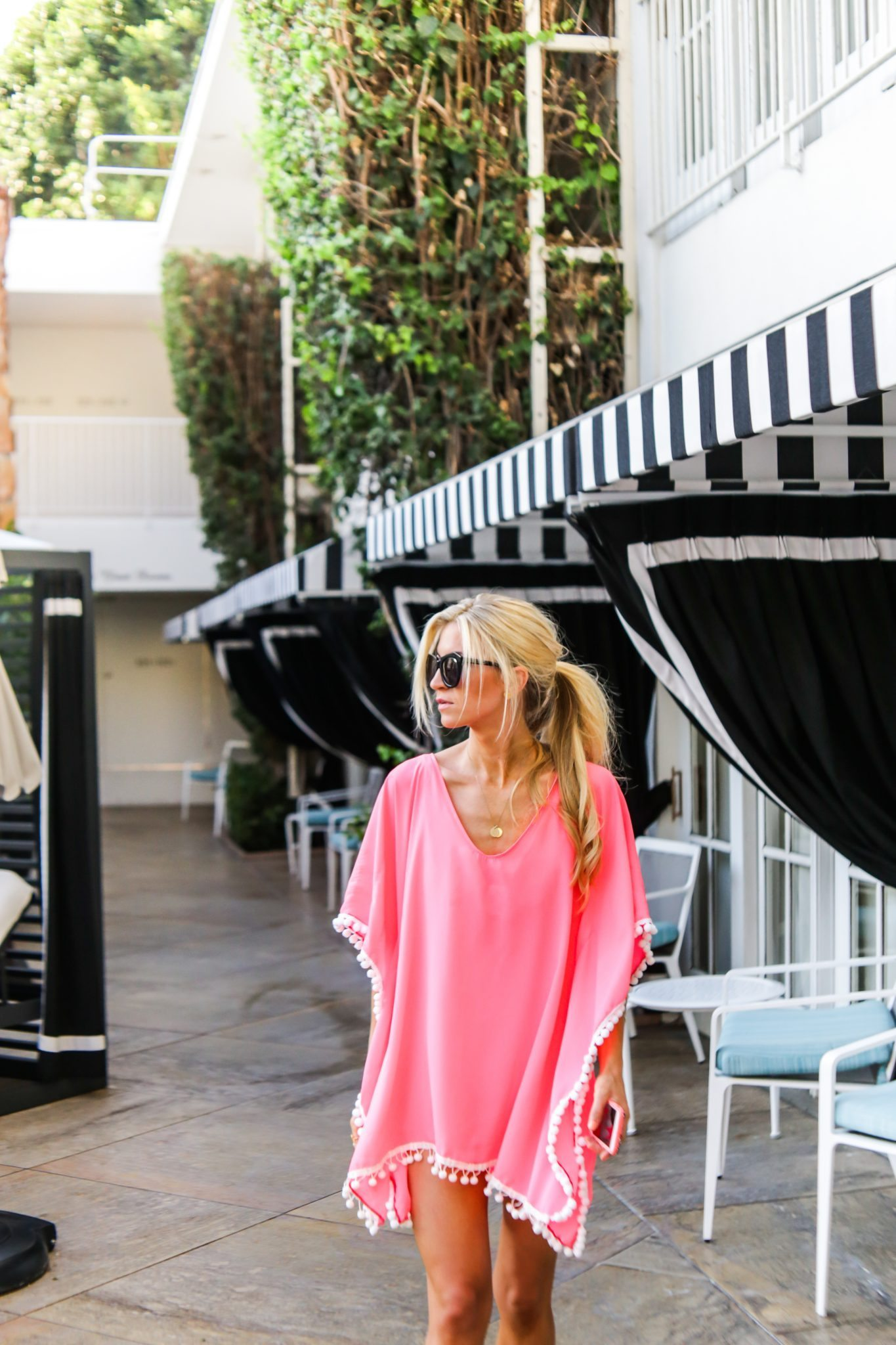 The cutest pink Pom pom trim kaftan swim cover up.