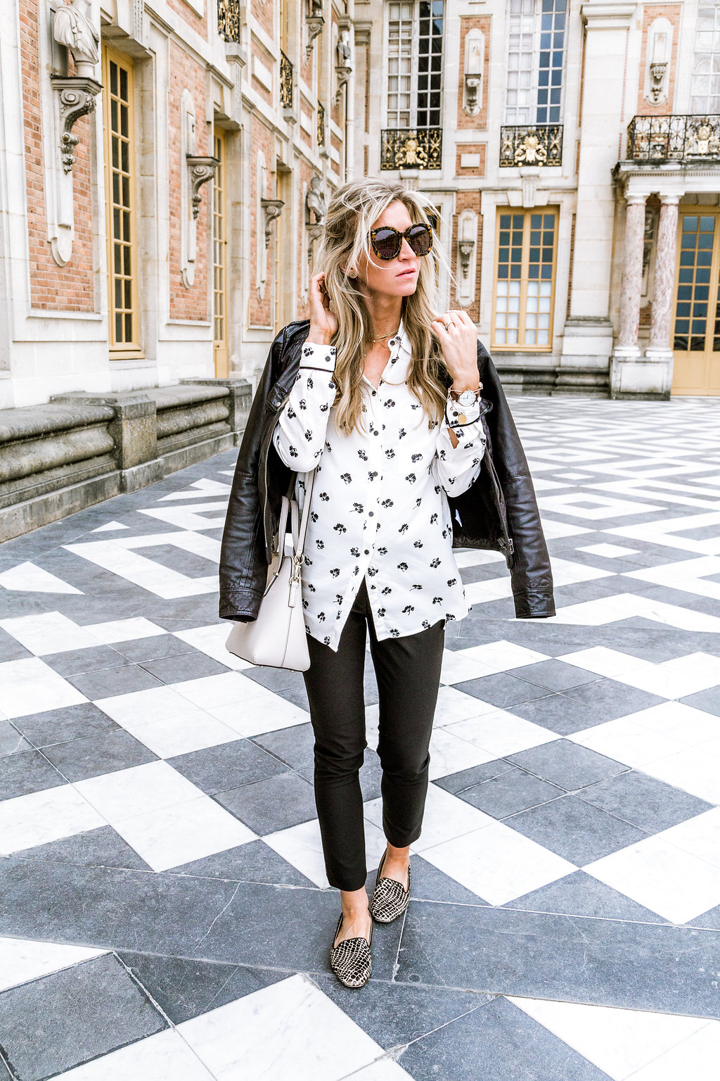 Leather jacket, floral top, leopard loafers.