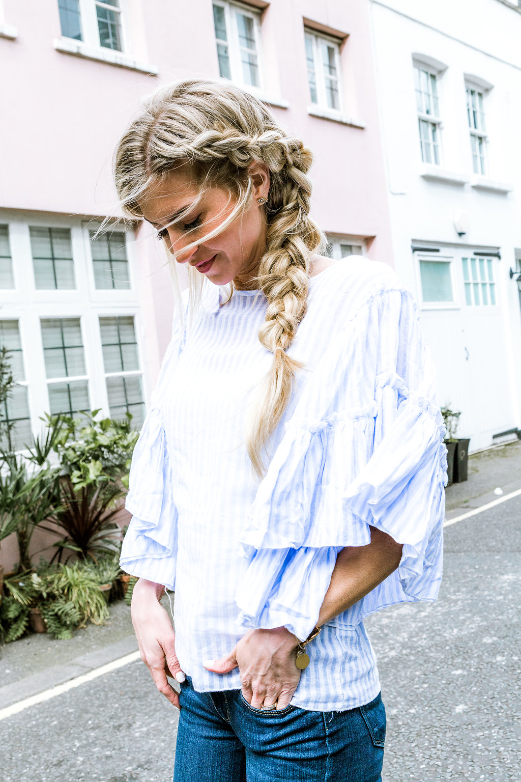 Blue ruffle sleeved top.