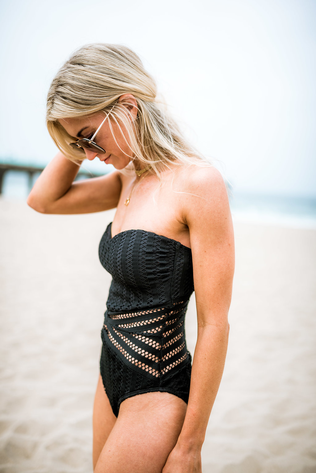 Black crochet one piece suit.