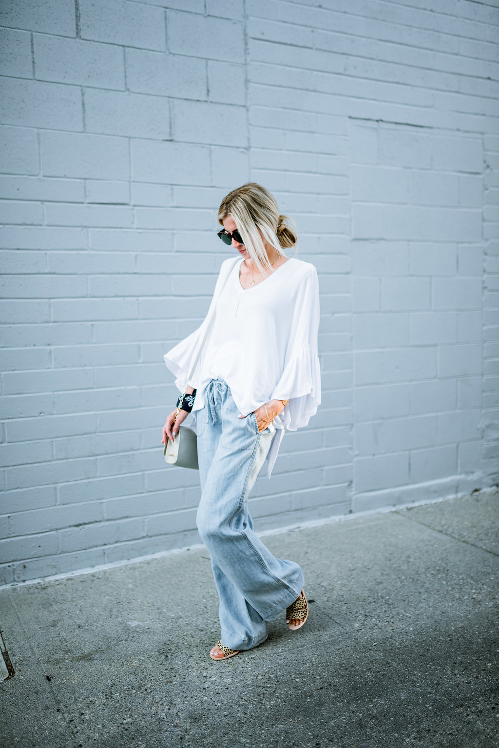 The trick to correctly styling wide leg pants.