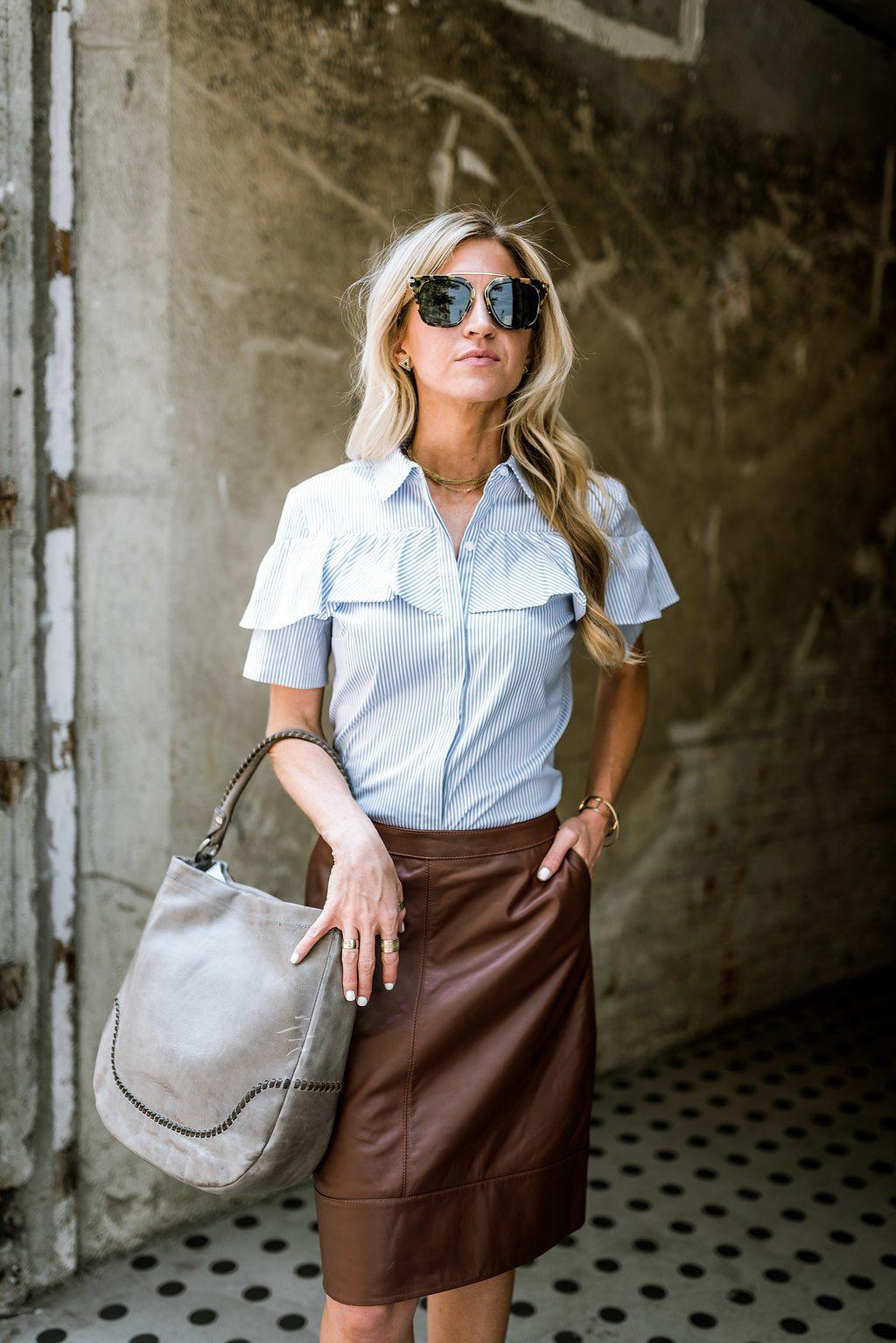 Light blue ruffle top + brown leather skirt