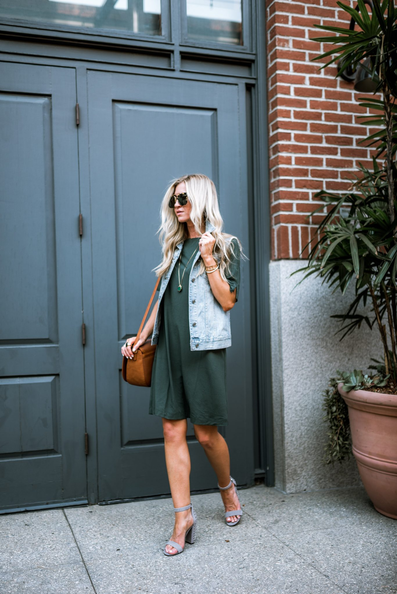 Olive swing dress + distressed denim vest.
