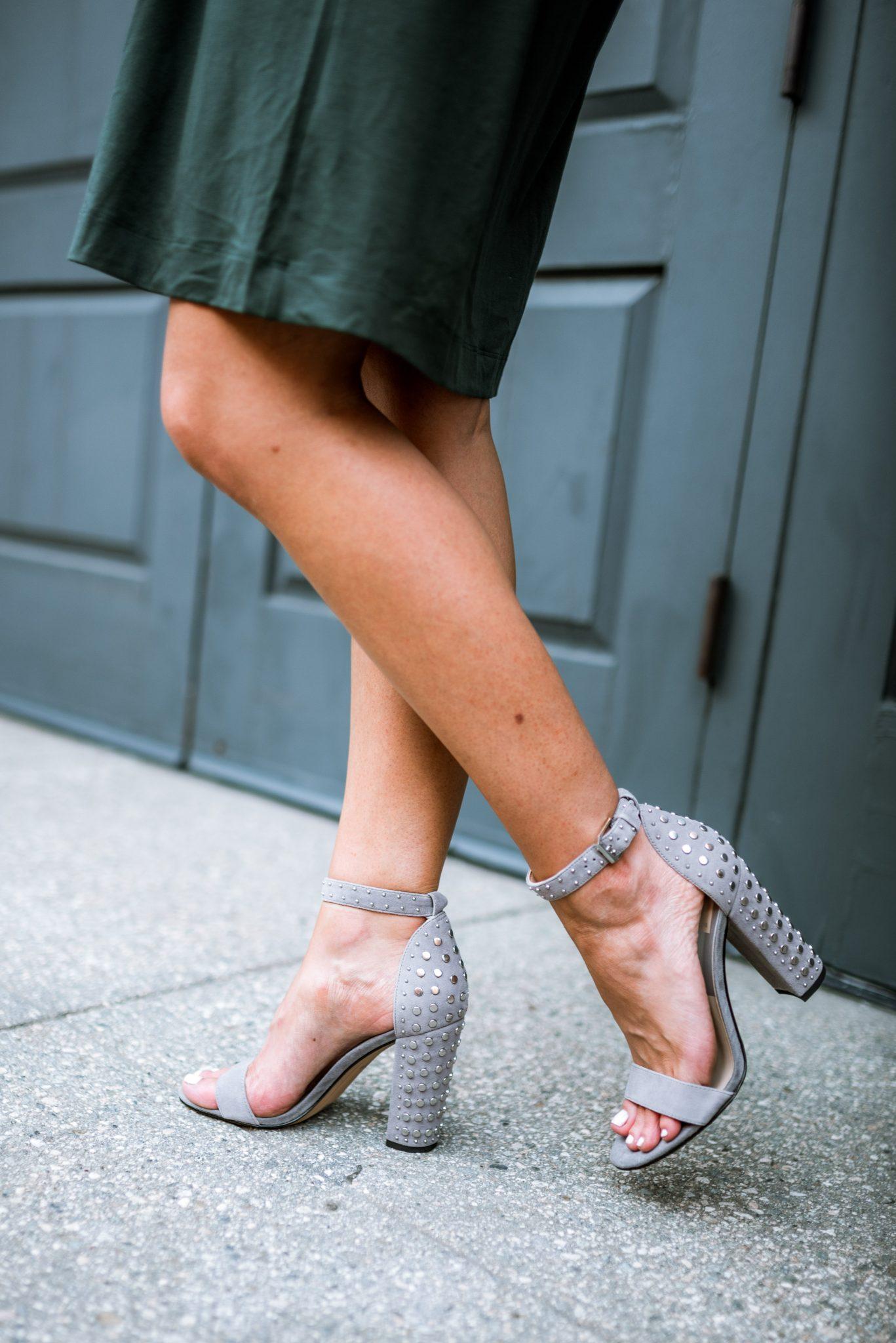 Grey studded sandals.