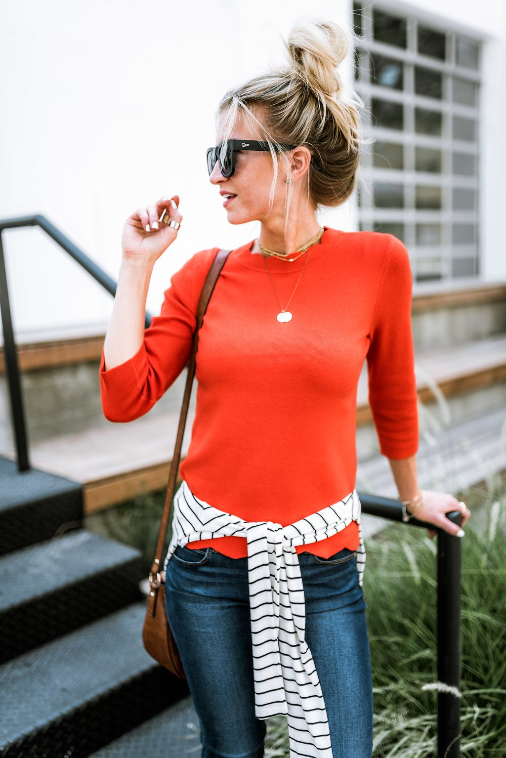 Red scalloped top + striped sweater