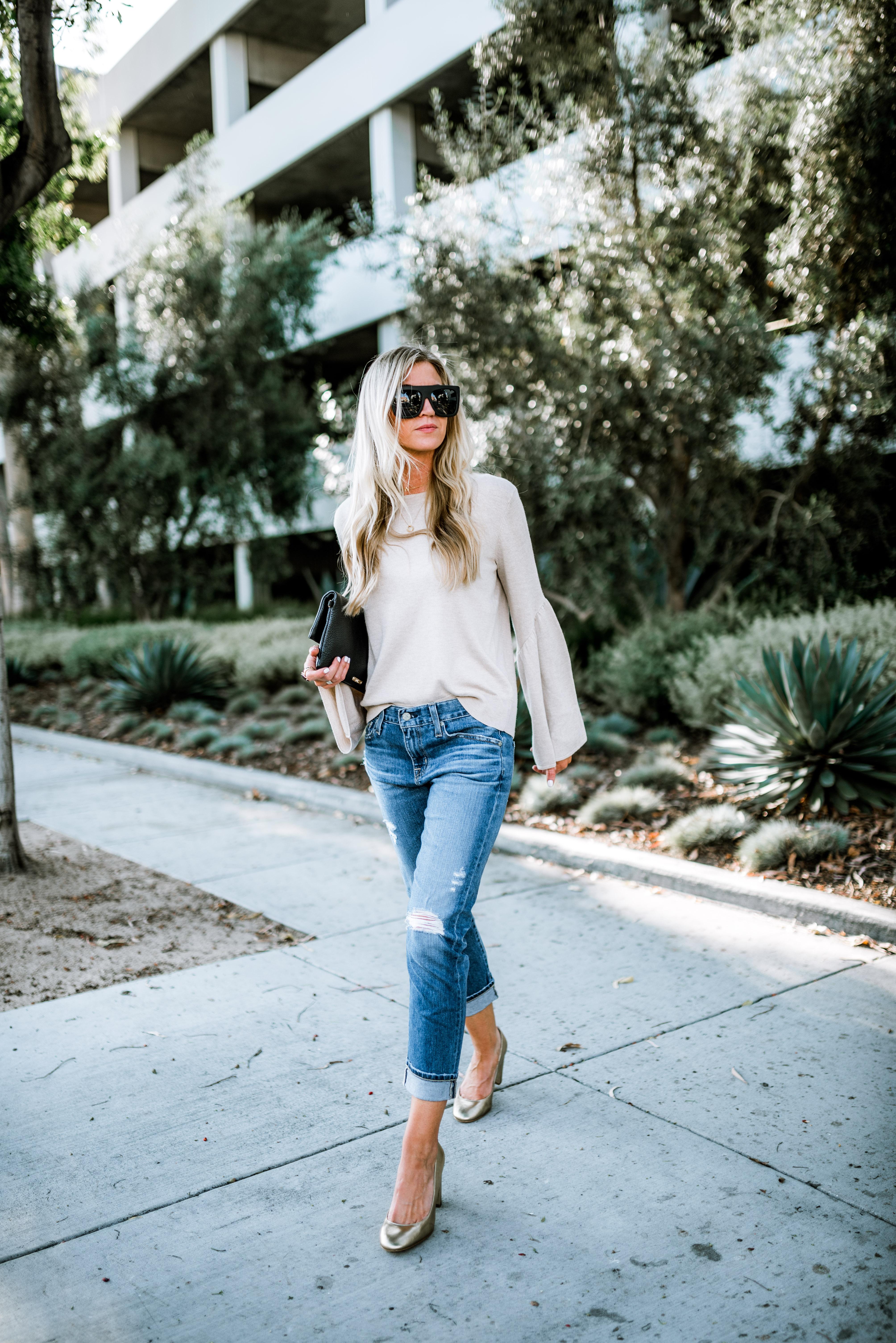 Camel bell sleeved sweater + gold heels.