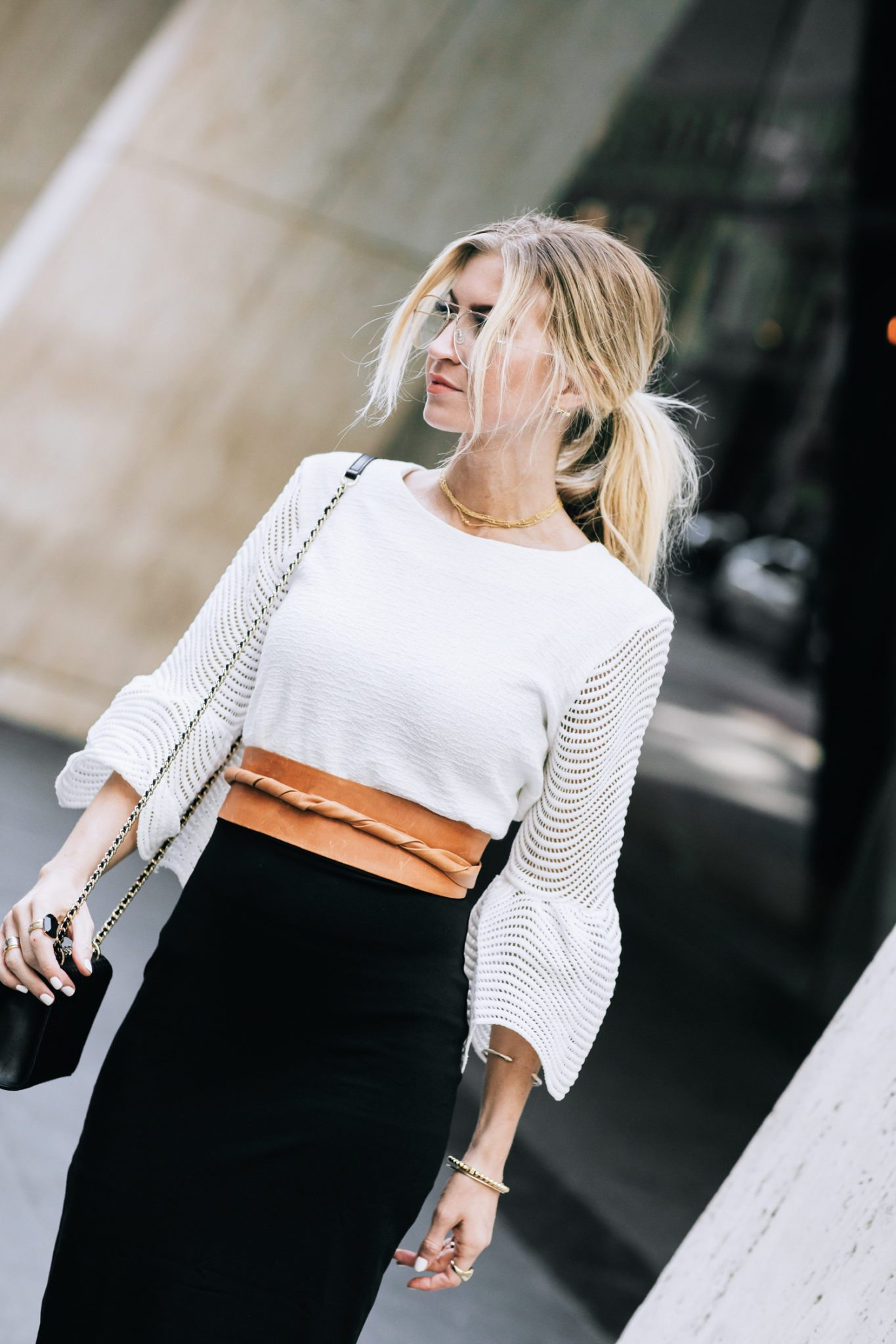 Black pencil skirt + wide cognac belt.