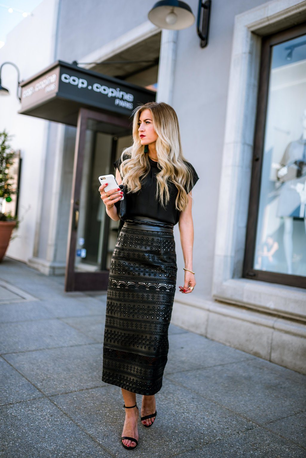 Black laser cut pencil skirt + emerald earrings