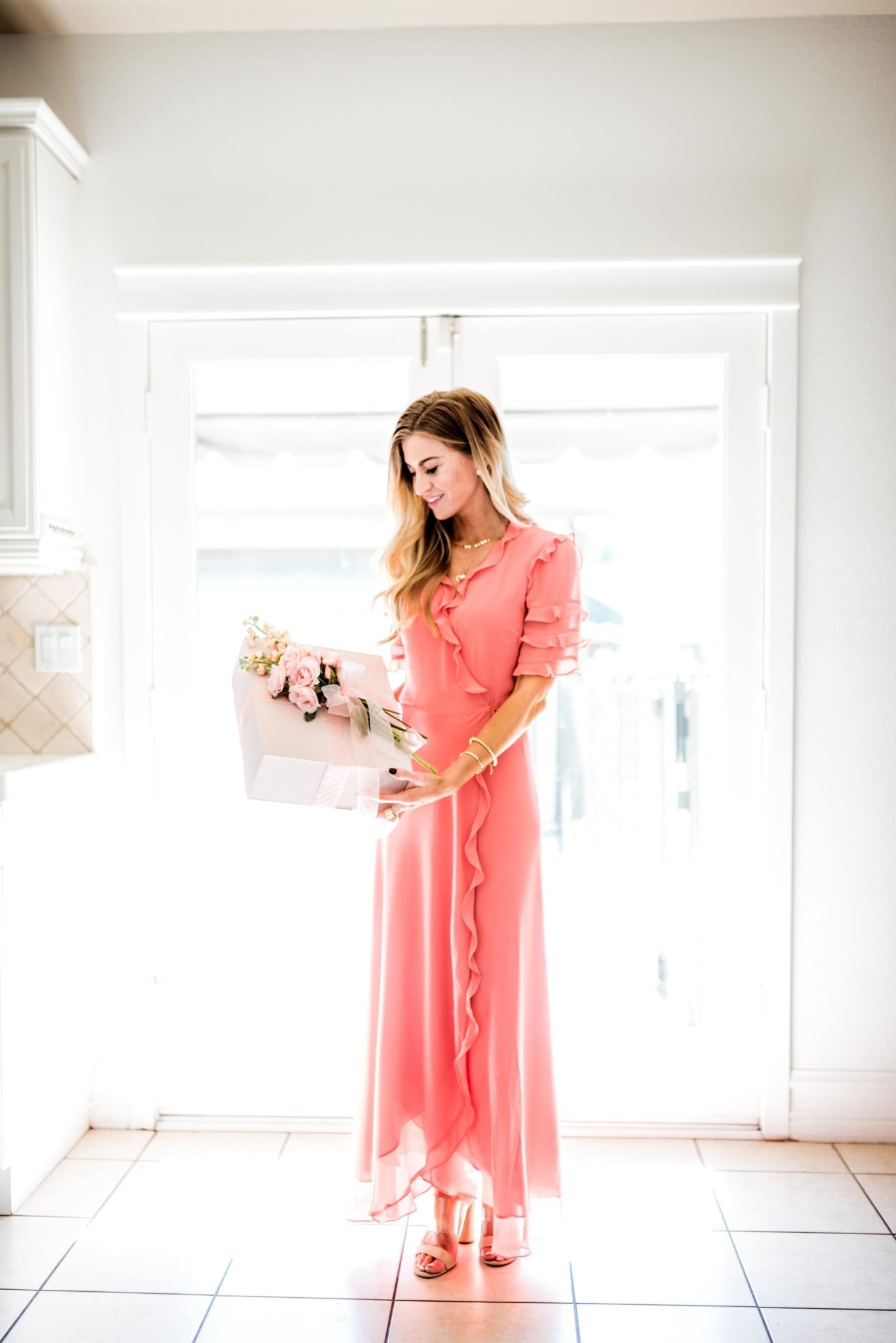 Coral pink ruffled wrap dress for spring