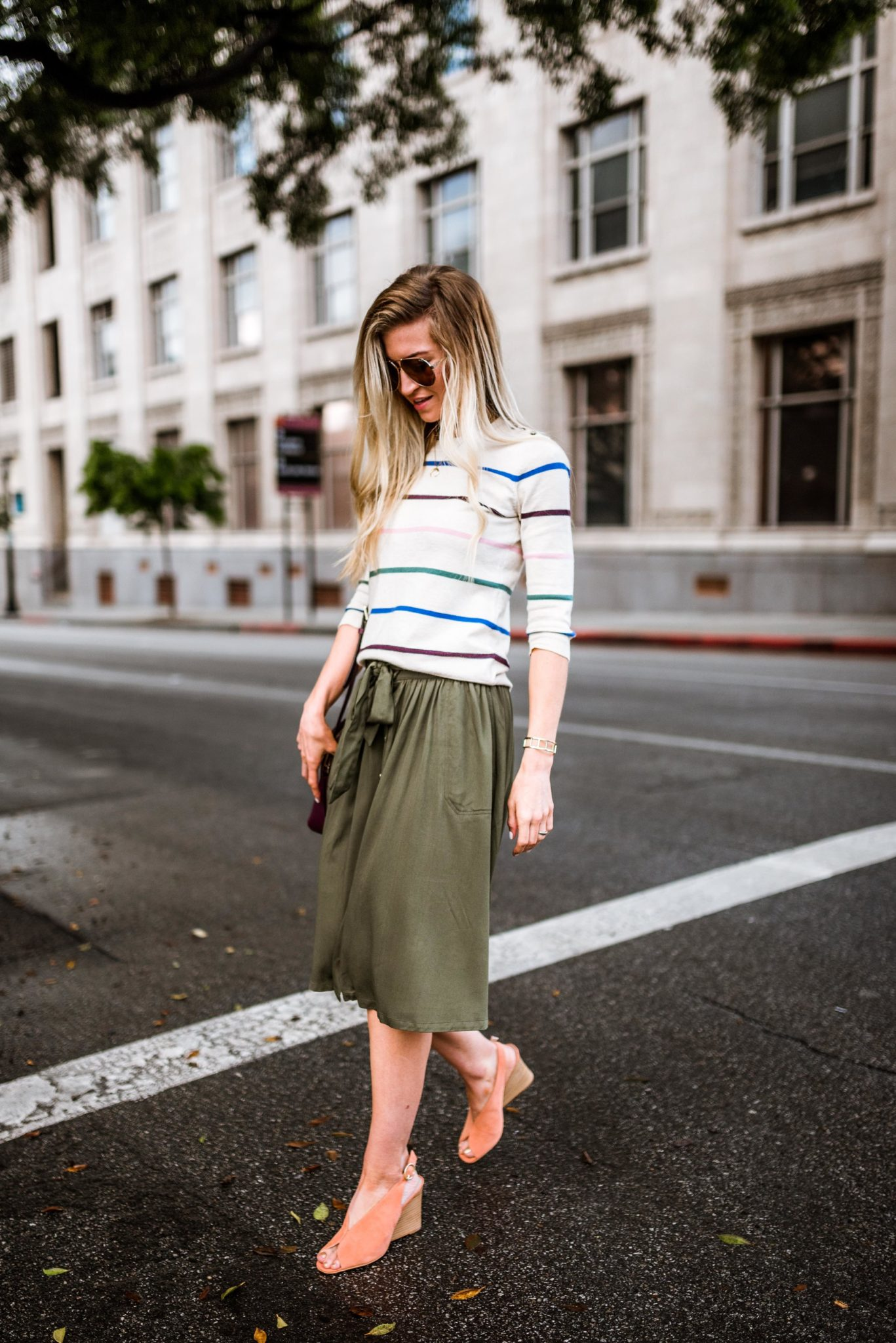 Striped sweater + olive green skirt