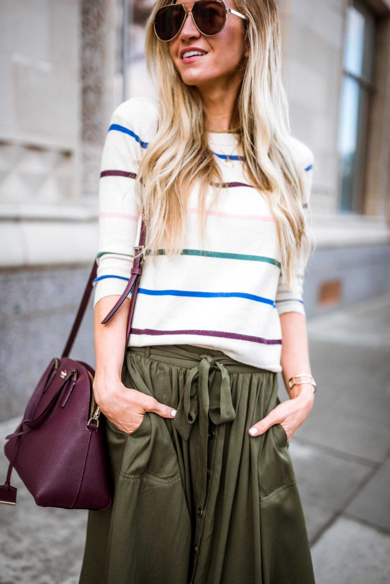 Striped sweater + olive green skirt + quay sunglasses