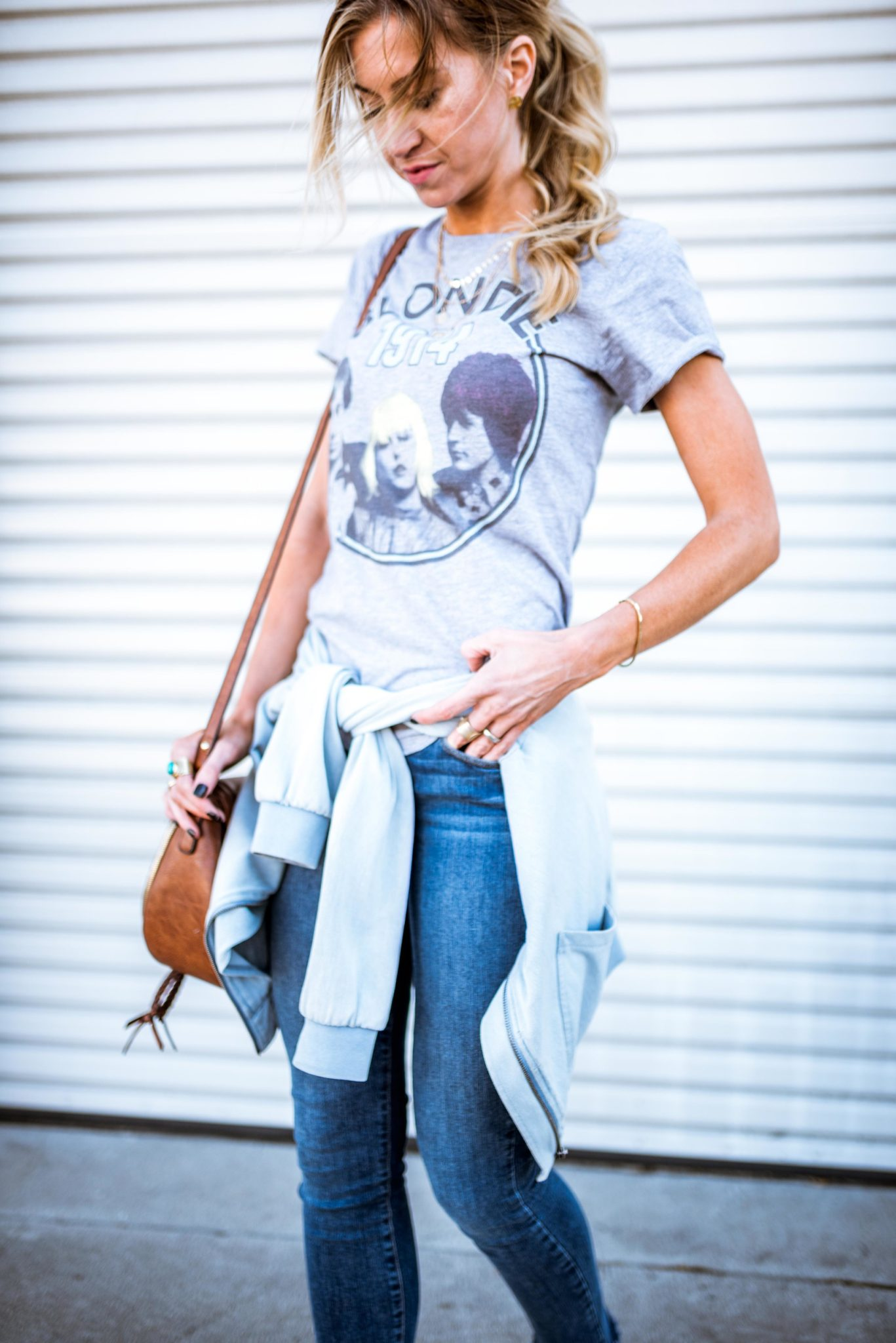 Blondie graphic tee, distressed jeans, chambray bomber jacket for spring.
