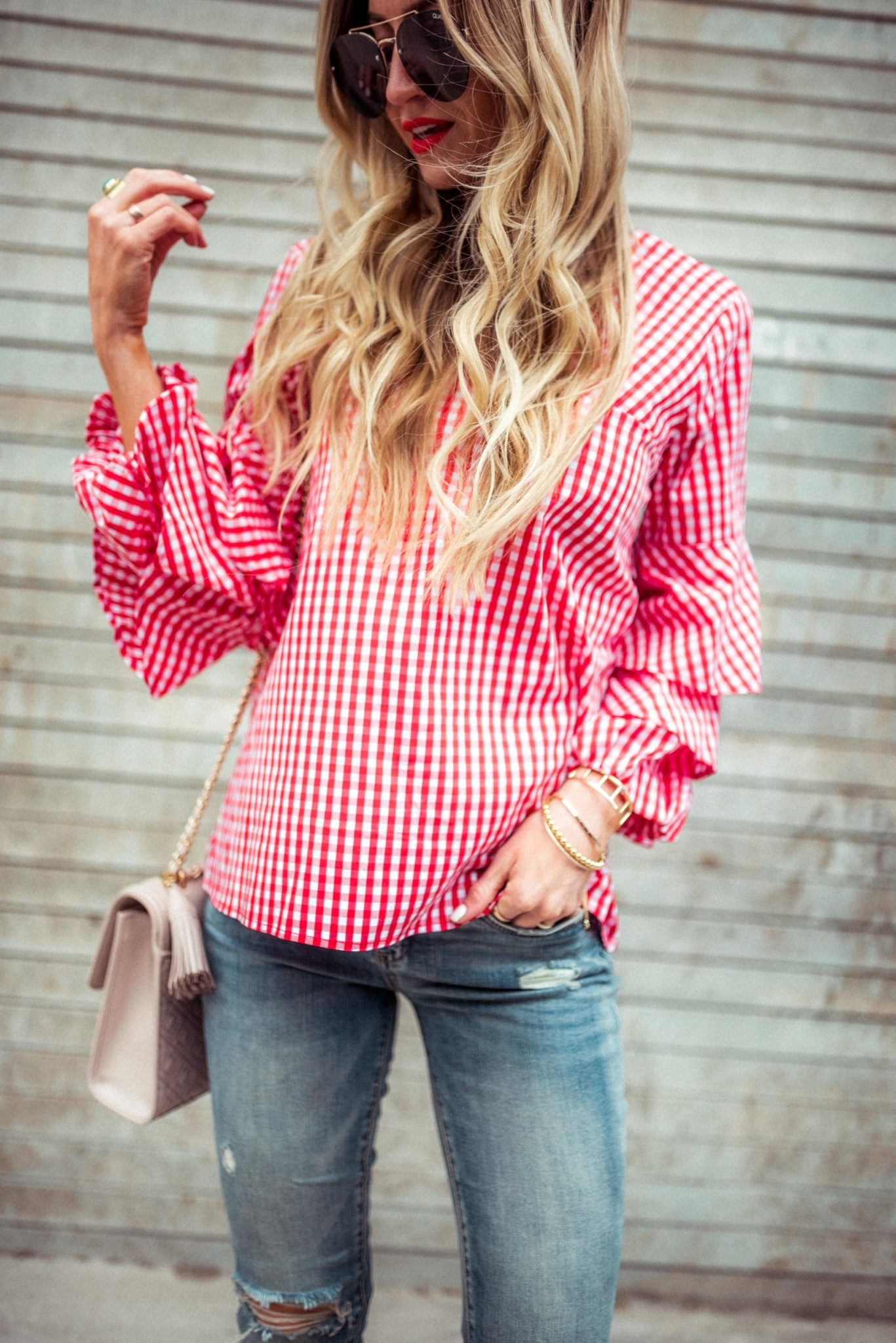 Red gingham ruffled top.
