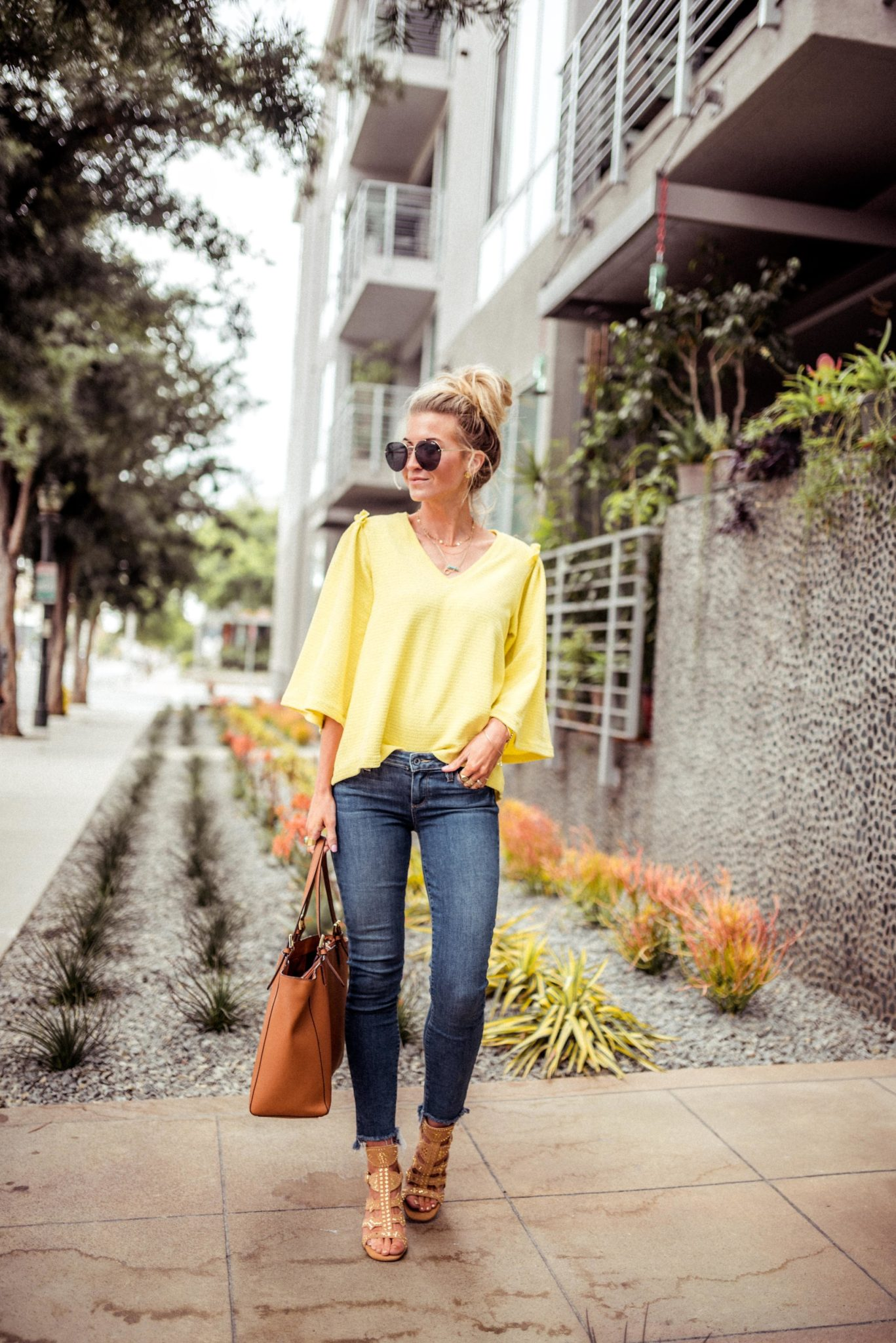 Yellow bell sleeve top.