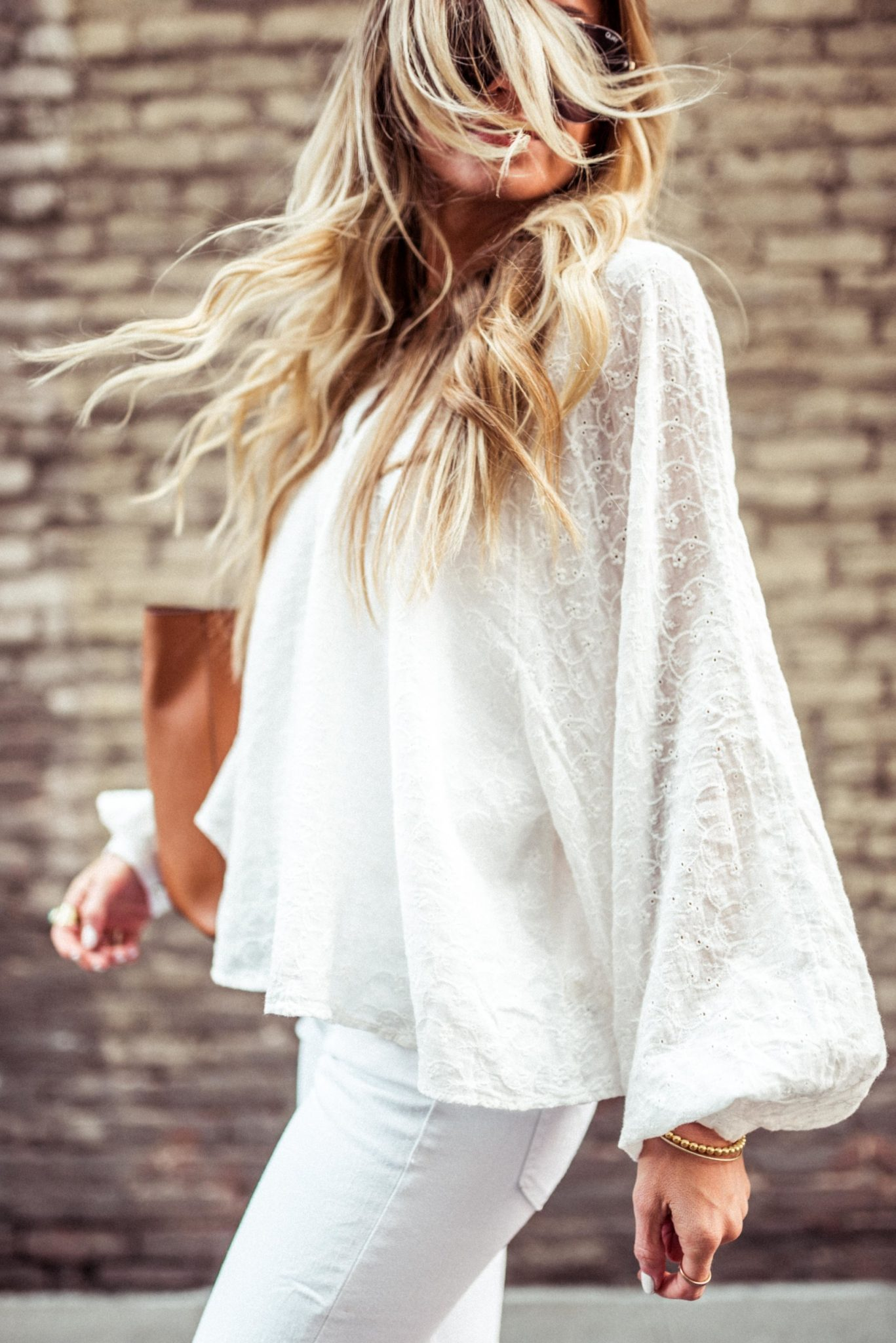 A list of white tops for Spring plus how to style an all white outfit