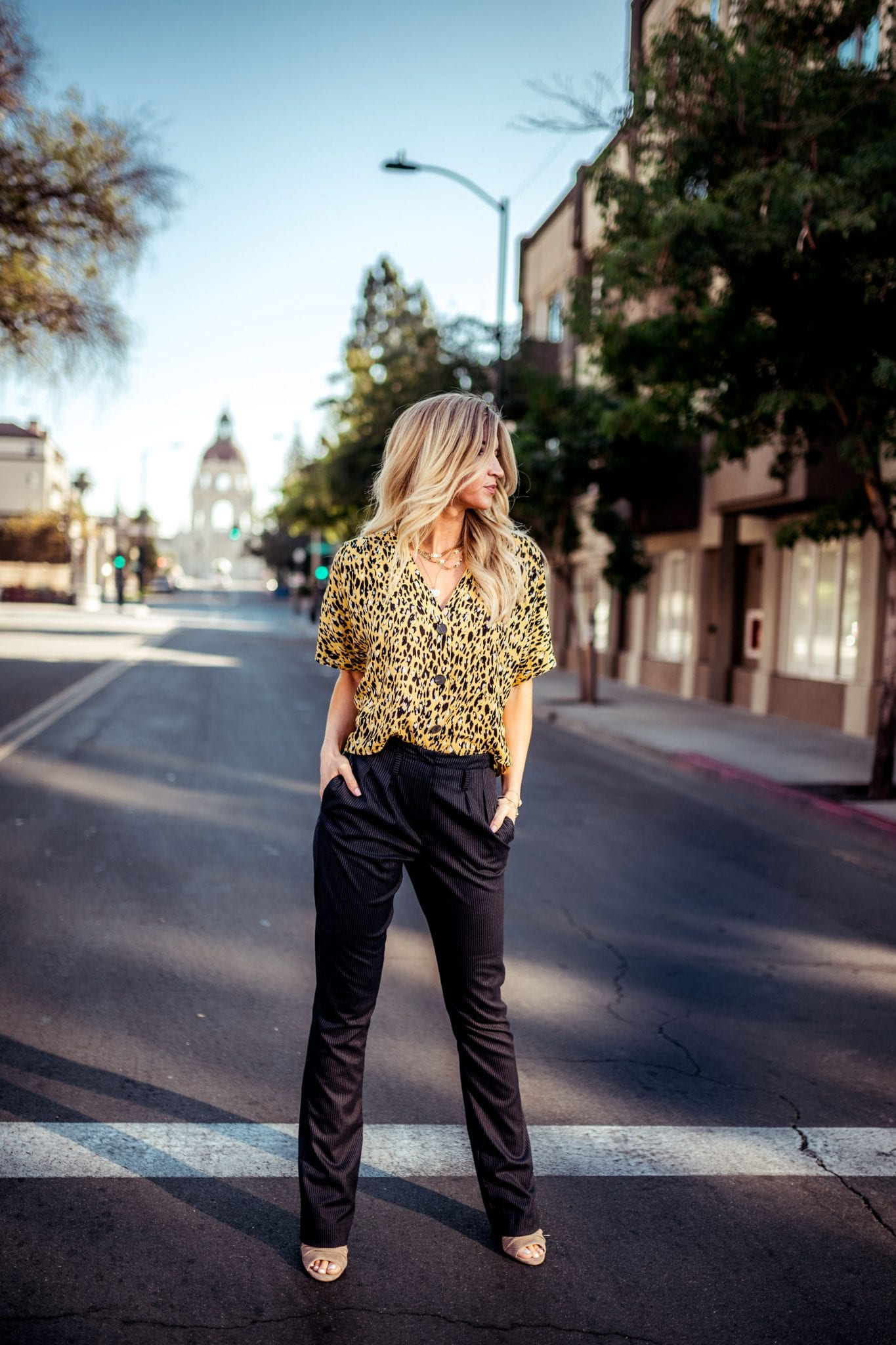 Animal print blouse + navy trousers